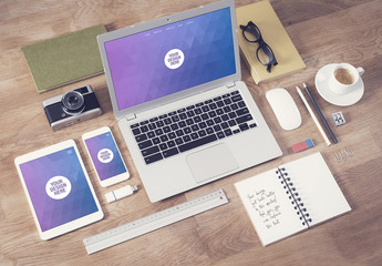 Laptop, Tablet, and Smartphone on Wooden Table with Note and Creative Tools Mockup