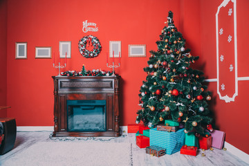 Beautiful new year room with decorated Christmas tree, gifts and fireplace. The idea for postcards. Soft focus. Shallow DOF