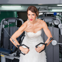 Bride in the gym. Workout before wedding