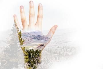 Hand on landscape background