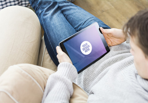 User Relaxing with Tablet Mockup 3