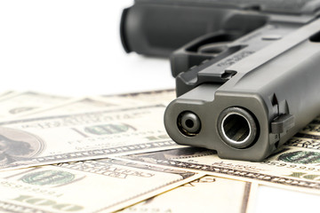 Close up image of pistol and dollar .