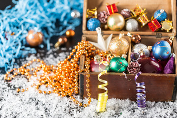 Colorful Christmas balls in a old wooden box
