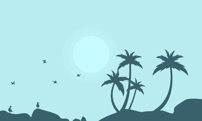 Silhouette of seabird and palm scenery