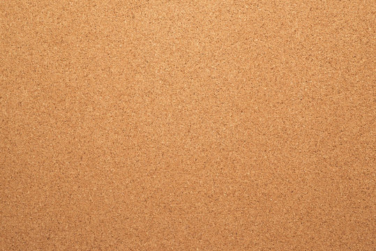 Brown cork board texture. Close up.