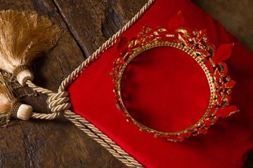 King's crown on red velvet