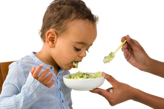 Toddler spitting out his vegetables