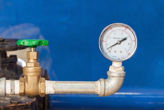 Water gauge pressure and valve in control room.