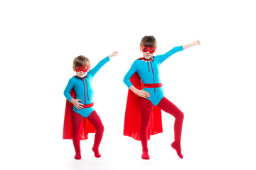 Children dressed as superheroes pose.