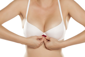 woman buttoned her white bra