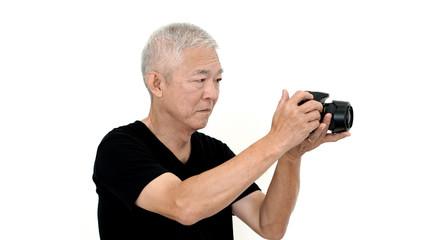 Asian senior man start photography as hobby on free time white i