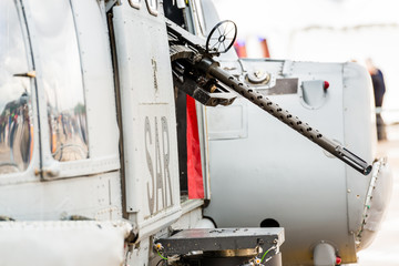 """A detail view focused on the machine gun of an Eurocopter Super Puma belonging to a Spanish Search And Rescue unit during the """"Aire75"""" Air Show Exhibition."""