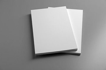 Blank notebooks on grey background