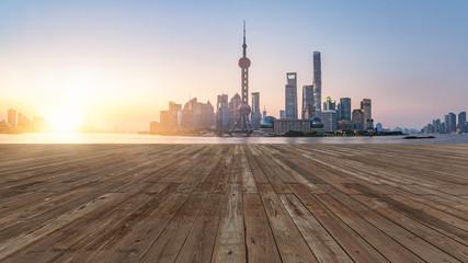 wooden floor front of shanghai bund skyline,digital composite.