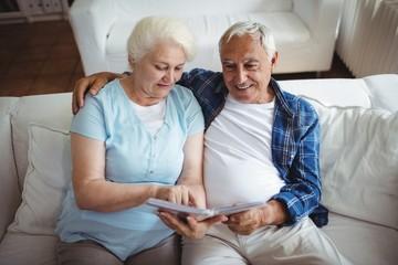 Senior couple looking at a photo album