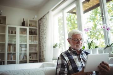 Senior man using digital tablet