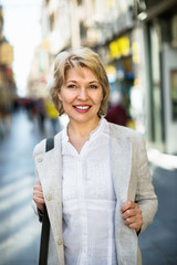 Portrait of smiling mature blond woman  in town