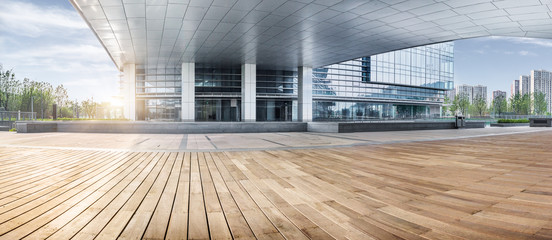 office building entrance with wooden floor foreground,china.