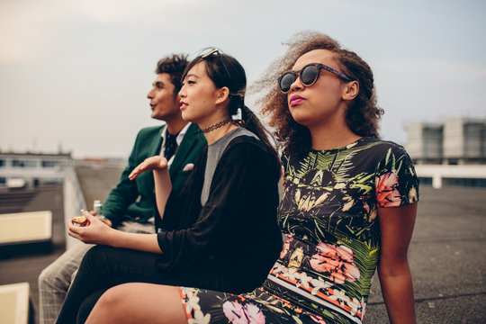 Young people sitting on rooftop