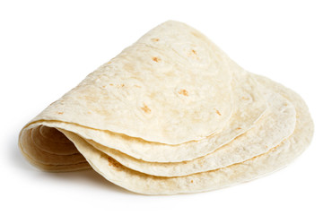 Stack of folded tortilla wraps  isolated on white.