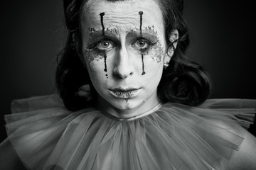 a clown woman sad bw