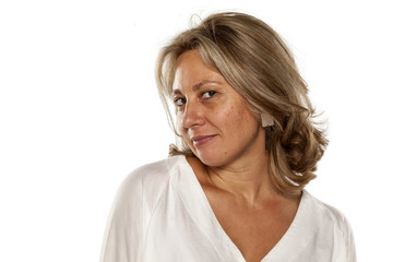 Portrait of beautiful and smiling middle-aged woman with no makeup