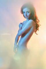 nude woman.colored spotlights