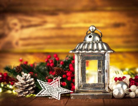 Christmas still life with lamp garland and balls