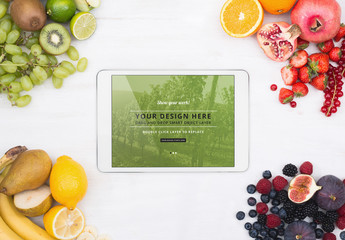Tablet Surrounded by Fruit Mockup