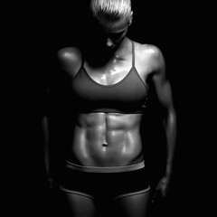 athletic fitness girl. gym concept. muscular woman, trained female body.healthy lifestyle