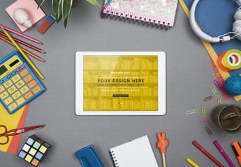 Tablet with Scattered School Supplies Mockup