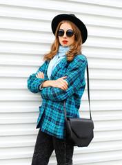 Fashion portrait pretty young woman model wearing black hat chec