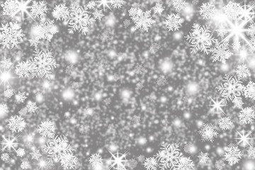 Christmas background with snowflakes, stars and place for text. Sparkly holiday background with copy space. Gray and silver background