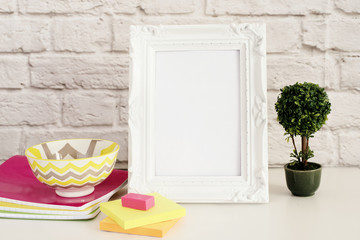 Frame Mock up. White Frame mockup. Styled Stock Photography. Notebooks, Bonsai Plant. Template Product Mock-up. Empty Frame on Brick Wall. White Vertical Frame on Gray Wall, Office Desk Accessories