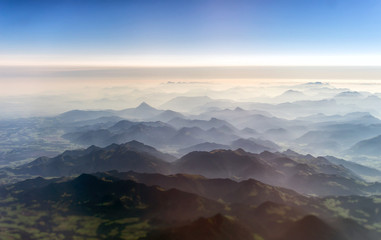 Foto op Canvas Luchtfoto Aerial view of the mountains in the clouds.