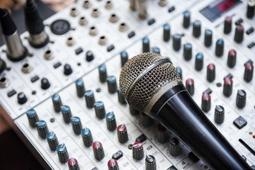Microphone close up on audio mixer