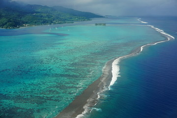 Aerial view of tropical lagoon and coral barrier reef of Raiatea island, south Pacific ocean, Society islands, French Polynesia
