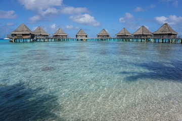 Overwater bungalows in the lagoon, seen from the seashore, Rangiroa atoll, south Pacific ocean, Tuamotu, French Polynesia