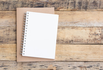 Open blank notepad on a wooden table