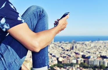 man using his smartphone in Barcelona, Spain