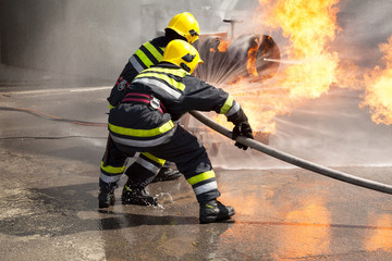 Firefighters in action. Fire department training.
