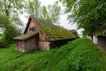 Traditional shingled stone granary - the old manor cellar typical for lesser Poland