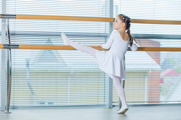 Little ballerina girl. Adorable child dancing classical ballet i