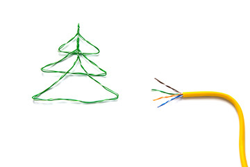 Christmas tree made from cables of Twisted pair RJ45 and yellow patch cord for Lan network. Concept of New Year, Christmas, internet connection, communication