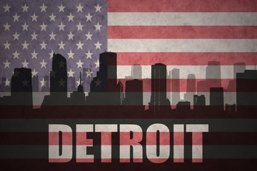 abstract silhouette of the city with text Detroit at the vintage american flag