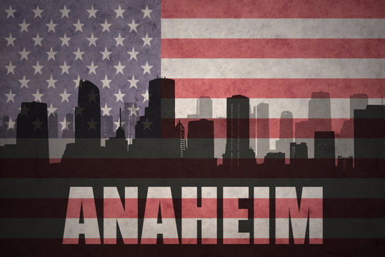 abstract silhouette of the city with text Anaheim at the vintage american flag