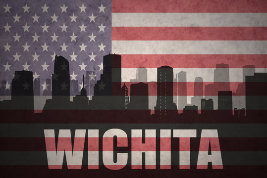 abstract silhouette of the city with text Wichita at the vintage american flag