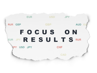 Finance concept: Focus on RESULTS on Torn Paper background