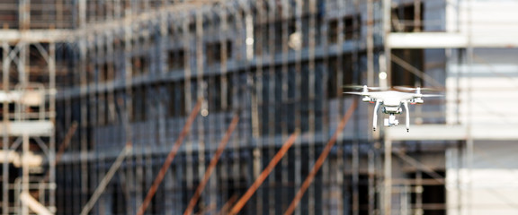 Quadcopter drone flying in a construction site
