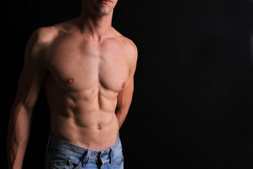 Strong attractive muscular Man, male body, torso, hair removal, six pack abs over black background, copy space